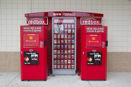 JACKSONVILLE, FL-APR 8: A Redbox Kiosk in Jacksonville, Florida on April 18, 2012. Coinstar Inc., the parent company of Redbox, has 35,400 DVD Rental Redbox kiosks in 29,300 locations in supermarkets, drug stores, mass merchants, convenience stores, and r Stock Photo - 13365313