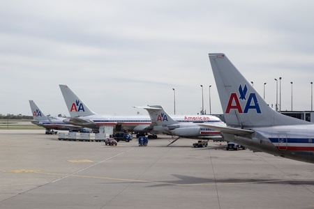 CHICAGO-APR 21: American Airlines aircraft at the Chicago Ohare International airport on April 21, 2012. American Airlines has approximately 900 aircraft and serves 250 cities in 50 countries with 3,400 daily flights. Stock Photo - 13365618