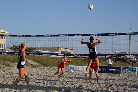 JACKSONVILLE BEACH, FL-APR 01: Women´s Sand Volleyball Teams of the University of North Florida (in blue) playing Florida Atlantic University in the UNF Sand Invitational on April 1, 2012 at Jacksonville Beach, FL. Stock Photo - 13775579