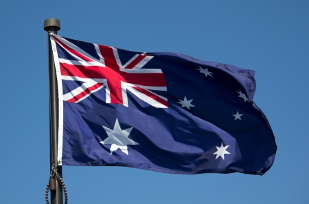The Australian Flag with blue sky background Stock Photo - 13765660