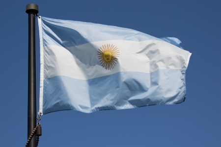 aires: The Argentina Flag blowing in the wind with blue sky Stock Photo