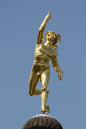 mercury staff: STUTTGART, GERMANY - JUNE 30: The gilt statue of the Roman God Mercury made by the German sculptor Johann Ludwig von Hofer in 1862, on top of the Old Chancellery Building on June 30, 2012 in Stuttgart, Germany. Editorial