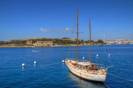 Sailboat and the city of Valletta in Malta. photo