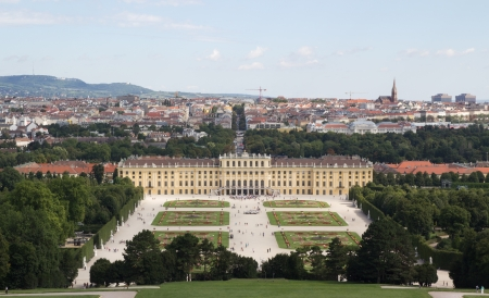 nbrunn: VIENNA, AUSTRIA - AUGUST 7: Tourist visiting the Schonbrunn Palace on August 7, 2011 in Vienna, Austria. The Palace, built in the year 1642,  is a former imperial 1,441 room summer residence.