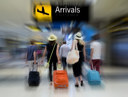 arrivals: Airline passengers in the airport Stock Photo