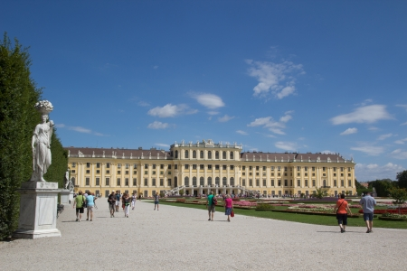 VIENNA, AUSTRIA - AUGUST 7: Tourist visiting the Schonbrunn Palace on August 7, 2011 in Vienna, Austria. The Palace, built in the year 1642,  is a former imperial 1,441 room summer residence.