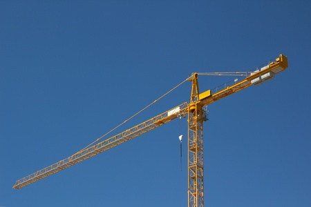 Construction Crane with clear blue sky. photo