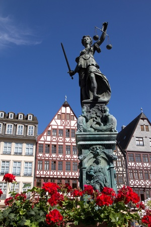 FRANKFURT, GERMANY - AUGUST 23: The Statue of Lady Justice in Romer Square on August 23, 2012 in Frankfurt, Germany. Romer Square had been the site for the Frankfurt city government for over 600 years.
