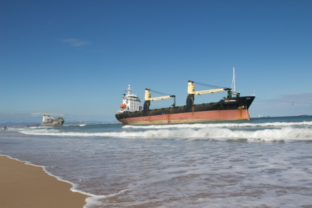 VALENCIA, SPAIN - SEP 30: The cargo ships BSLE Sunrise of Panama (foreground) and the Celia of St Johns runs aground at the El Saler Beach after a big storm on September 30, 2012 in Valencia, Spain. 新聞圖片