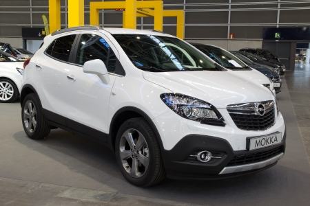 automaker: Valencia, Spain - December 7 - A 2012 Opel Mokka Compact SUV at the Valencia Car Show on December 7, 2012 in Valencia, Spain. The Mokka is engineerd by the German automaker Opel and produced in South Korea.