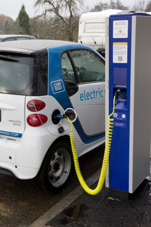 STUTTGART, GERMANY - NOV 30: A Car2go electric car at one of the 500 charging points on November 30, 2012 in Stuttgart, Germany. Car2go has over 300 electric Smart cars in the city of Stuttgart.