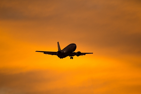 colo: Silhouette of a aircraft approaching the airport.