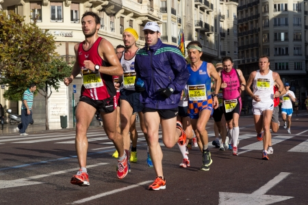 VALENCIA, SPAIN - NOVEMBER 18: Runners compete in the XXXII Valencia Marathon on November 18, 2012 in Valencia, Spain.  Editorial