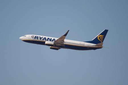 VALENCIA, SPAIN - JULY 8: A Ryanair Boeing 737-800 aircraft just after takeoff from the Valencia, Spain Airport on July 8, 2013 in Valencia, Spain. Ryanair is the biggest low-cost airline company in the world.