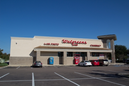 car retailer: JACKSONVILLE, FL - NOV 28: A Walgreens store in Jacksonville, Florida on November 28, 2013. Walgreens is the largest drug retailing chain in the United States with 8,582 stores in all 50 states, the District of Columbia, Puerto Rico, and Guam.