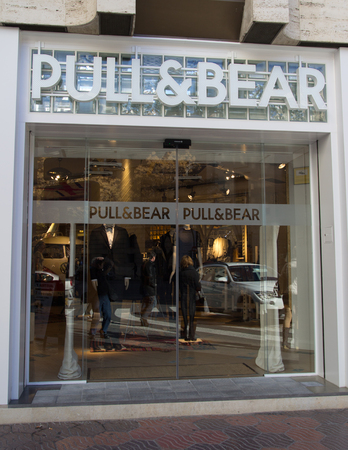 forsale: VALENCIA, SPAIN - DEC 27: A Pull & Bear retail clothing store in Valencia, Spain on December 27, 2013. Pull & Bear started in 1991 and currently has 850 retail clothing stores internationally.  Editorial