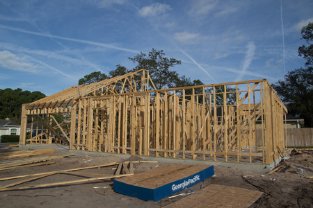 urban sprawl: JACKSONVILLE, FL-SEP 11: A new home under construction on September 11, 2013 in Jacksonville, Florida. New home sales fell 6.6 percent in September to a 354,000 annual rate, the weakest since April 2012.
