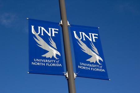 undergraduate: JACKSONVILLE, FL- NOVEMBER 23, 2013: A University of North Florida (UNF) banner on the UNF campus. UNF is organized into 5 colleges with 53 undergraduate programs and 28 graduate programs.  Editorial