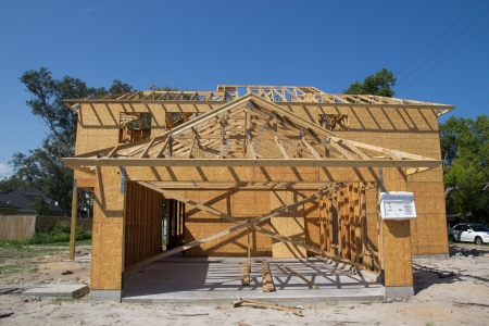 house under construction: JACKSONVILLE, FLORIDA, USA-SEPTEMBER 15, 2013: A new home under construction in Florida. New home sales fell 6.6 percent in September to a 354,000 annual rate, the weakest since April 2012.