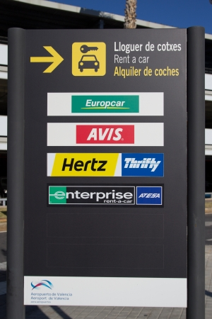 hertz: VALENCIA, SPAIN - JANUARY 21, 2014: A rental car sign at the Valencia airport.  The rental car industry is a 31 billion dollar industry worldwide with Hertz having 28% of the market share.