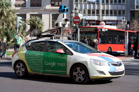 google: VALENCIA, SPAIN - JANUARY 27, 2014: A Google Street View vehicle used for mapping streets throughout the world drives through the town center of Valencia, Spain. Google Street View started in May 2007.  The car has nine directional cameras for taking 360� Editorial