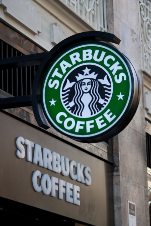 starbucks: VALENCIA, SPAIN - JANUARY 27, 2014: Exterior of a Starbucks Coffee coffeehouse. Starbucks is the largest coffeehouse company in the world, with 20,891 stores in 62 countries (2013).