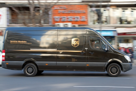 VALENCIA, SPAIN - JANUARY 28, 2014: An UPS delivery van on the street in Valencia. UPS is one of largest package delivery companies worldwide with 397,100 employees and USD 54.1 billion revenue (2012).