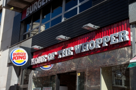 reported: VALENCIA, SPAIN - JANUARY 28, 2014: Burger King fast food restaurant in Valencia. At the end of fiscal year 2013, Burger King reported it had over 13,000 outlets in 79 countries.