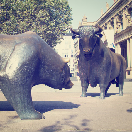 frankfurt stock exchange: A Bull and Bear Statues in public area.