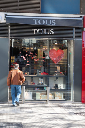 VALENCIA, SPAIN - FEBRUARY 6, 2014: A Tous retail store on a street corner in Valencia. Tous is a Spanish jewelry, accessories and fashion firm based in Catalonia, Spain with over 400 stores in 45 countries.
