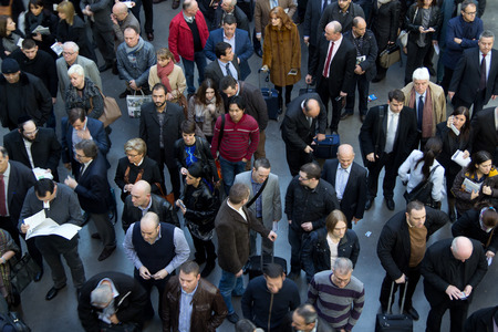 VALENCIA, SPAIN - FEBRUARY 12, 2014: A crowd of business people waiting to enter the 2014 Feria Habitat Valencia Trade Fair in Valencia.  Editorial