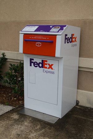 JACKSONVILLE, FL-FEBRUARY 22, 2014: A FedEx Express drop box in Jacksonville. FedEx Express is the world's largest express transportation company and delivers packages and freight to more than 375 destinations in nearly every country each day.