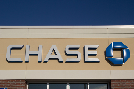bank branch: JACKSONVILLE, FL - MARCH 9, 2014: A Chase logo at a bank branch in Jacksonville. Chase bank is a US bank with more than 5,100 branches and 16,100 ATMs nationwide.