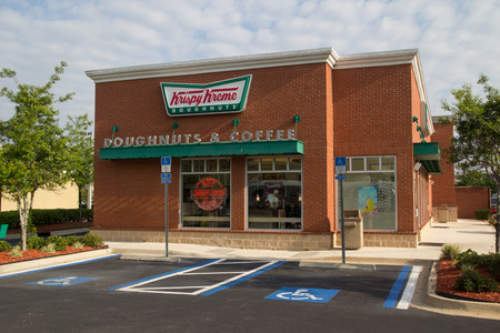 bakery products: JACKSONVILLE, FL - APRIL 27, 2014: A Krispy Kreme Doughnuts store in Jacksonville. Krispy Kreme was founded on July 13, 1937 by founder Vernon Rudolph. Editorial