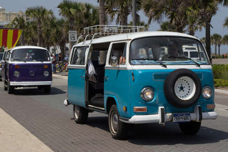 officially: JACKSONVILLE BEACH, FL - APRIL 27, 2014: A classic Volkswagen Van at the 68th annual Opening of the Beaches Parade. Each year the parade officially opens the beaches for the summer months.