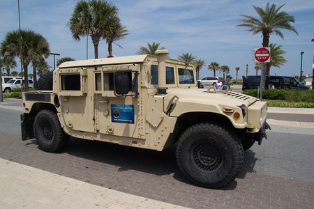 officially: JACKSONVILLE BEACH, FL - APRIL 27, 2014: A Military Humvee at the 68th annual Opening of the Beaches Parade. Each year the parade officially opens the beaches for the summer months.