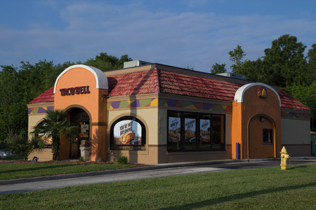billion: JACKSONVILLE, FL - APRIL 27, 2014: A Taco Bell fast-food restaurant in Jacksonville. Taco Bell serves more than 2 billion customers each year in more than 5,800 restaurants.
