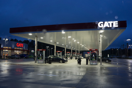 JACKSONVILLE, FL - MAY 2, 2014: A Gate Petroleum gas station on a rainy morning in Jacksonville. Gate Petroleum is headquartered in Jacksonville and has over 225 gas stations in six states with over 2,200 employees. Redakční
