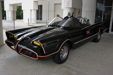 collectable: JACKSONVILLE BEACH, FL - MAY 3, 2014: A 1960s era Batmobile from the TV series on display at the Beaches Public Library in Jacksonville Beach. Editorial