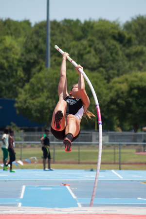 JACKSONVILLE, FL - APRIL 26, 2014: A woman pole vaulting at the University of North Florida Invitational Track and Field Meet.