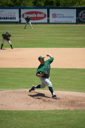 JACKSONVILLE, FL - APRIL 26, 2014: A pitcher from Stetson University throws a pitch during a baseball game against the Universtiy of North Florida.