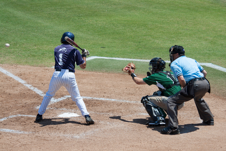 JACKSONVILLE, FL - APRIL 26, 2014: A batter from the University of North Florida takes a pitch during a baseball game against Stetson Universtiy.