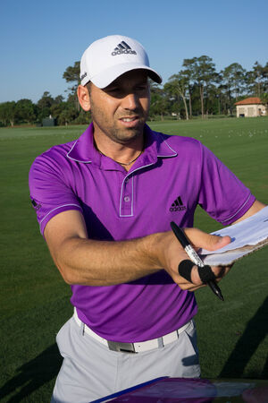 sawgrass: PONTE VEDRA BEACH, FL-MAY 6, 2014: Sergio Garcia at The Players Championship, PGA Tour, signing autographs on practice day at The TPC Sawgrass golf course.