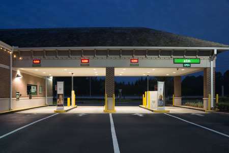 thru: JACKSONVILLE, FL - MAY 13, 2014: A Regions Bank Drive Thru at night. Regions Bank operates 1,700 branches and 2,400 ATMs across 16 southern states in the U.S.