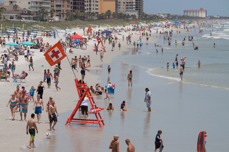 JACKSONVILLE BEACH, FL-MAY 18, 2014: Crowds enjoying Jacksonville Beach on a weekend. Jacksonville Beach is 15 miles east of Jacksonville and has a population of 21,362 at the 2010 census. Editorial