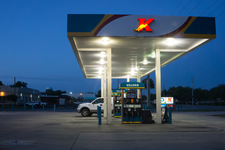 convenient store: JACKSONVILLE, FL-MAY 17, 2014: A Kangaroo Express store gas station at night. The Pantry Inc company operates the Kangaroo Express stores with 1,537 stores in thirteen states.