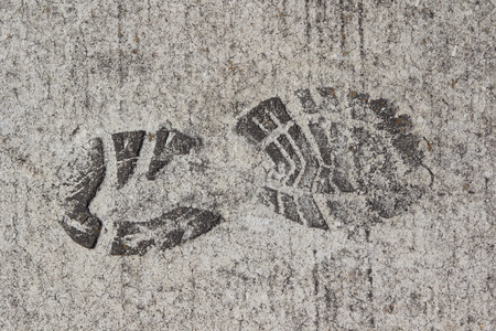 A Boot Print in Cement photo