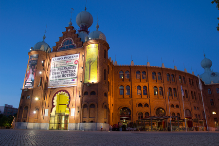renovated: LISBON, PORTUGAL - MAY 28, 2014: The Campo Pequeno bullring in early evening. Built in 1892, it was renovated in 2006 as a multi-event venue, apart from bull fighting.