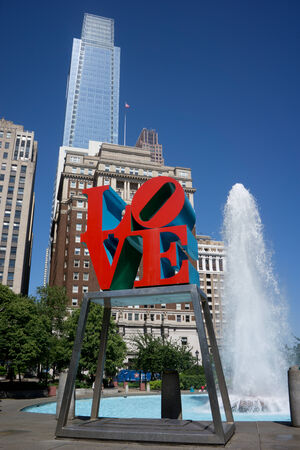 robert: PHILADELPHIA - MAY 25, 2014: Love Park in Philadelphia. Close up of the parks Love sculpture, built by Robert Indiana, was placed in the park in 1976 as part of the Bicentennial celebration. Editorial