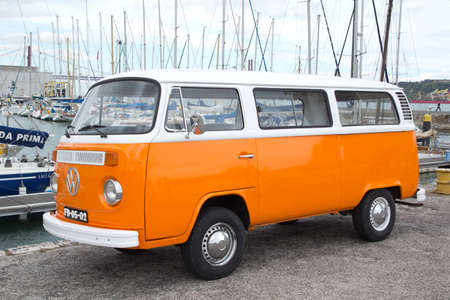 vw: LISBON, PORTUGAL - MAY 27, 2014  VW Transporter van parked in Lisbon  The famous van is currently considered a classic oldtimer, popular with collectors  Editorial
